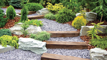 landscape fabric under crushed rock gravel stairs