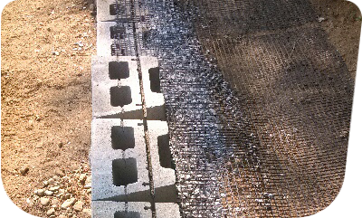 geogrid placed under blocks behind a retaining wall
