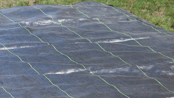 Image of a close up of woven ground cover fabric.
