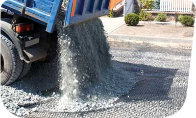 Road base grid for stabilzing gravel driveway