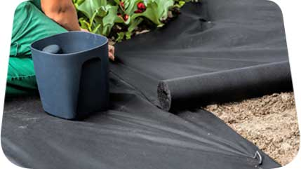 Using non woven fabric as a weed barrier